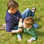 Little Boys Playing in the Grass